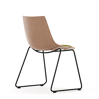 Wood chair with green seat pad and skid frame