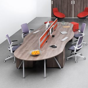 Wavy long desk in an office with four chairs, showing how to make hot desking work