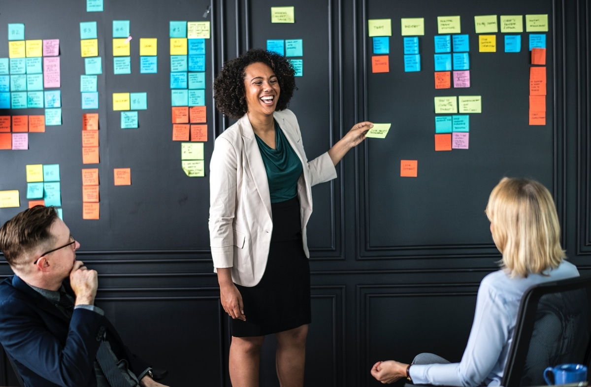 Woman laughing while running an ideas workshop